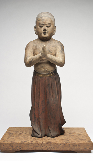 Standing Prince Shotoku at age two, Kamakura period (1185 – 1333), late 13th – 14th century, colors and lacquer on wood with crystal inlay. (Courtesy of Asian Art Museum)