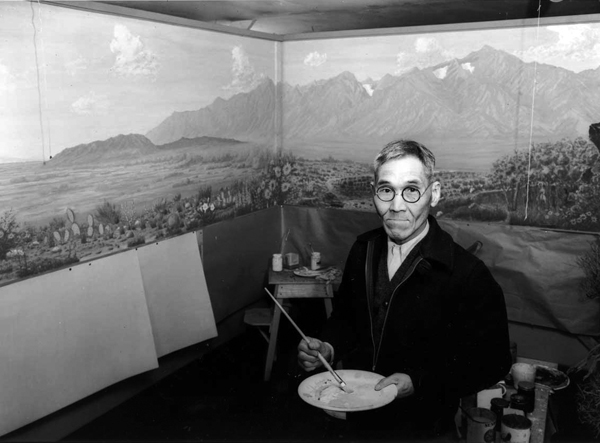 Tamekichi Carl Hibino painted the Owens Valley mural in 1943, while incarcerated in Manzanar. Photo by Ansel Adms, courtesy Library of Congress.