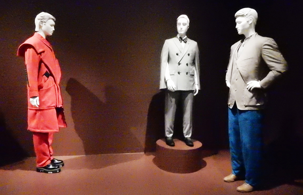 Japanese Designers: from left, Overcoat and Trousers (c. 1980) by Kansai Yamamoto, Jacket and Trousers by Rei Kawakubo for Comme des Garcons, and Ensemble (1982 – 90) by Issey Miyake. (Collection of LACMA and loaned)