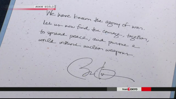 Obama's Inscription at a guestbook in the Hiroshima Peace Memorial Museum. (Source: NHK World)