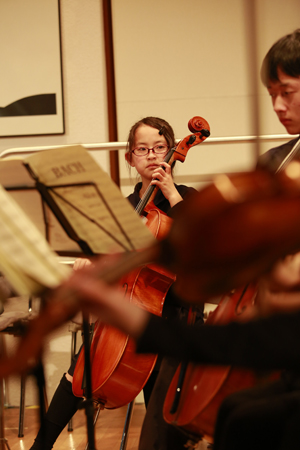 Risa Yoshida and her cello at Soma Children Orchestra