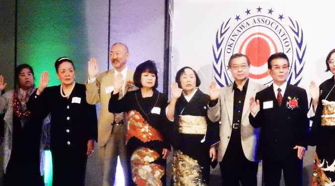 2017 board members, officers, chairpersons installation of the Okinawa Association of America. The third person from left is Edward Kamiya, new president. (Cultural News Photo)